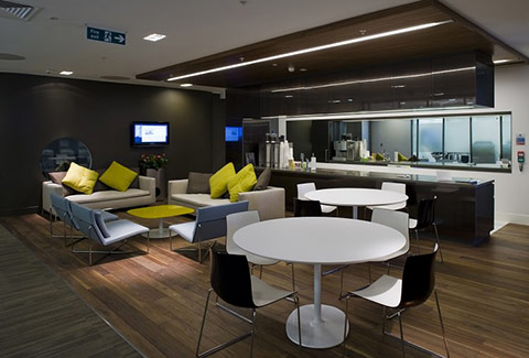 a photo of a modern sophisticated breakout area for relaxed business