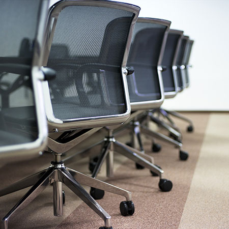 Photo of the backs of modern office chairs