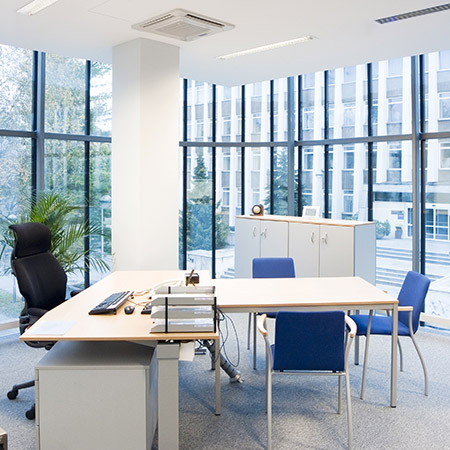 Photo of desk with meeting chairs in modern office