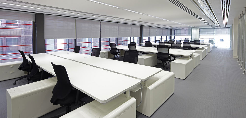 Photo of contemporary open plan office with roller blids